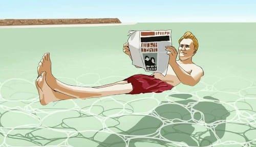 死海に浮く